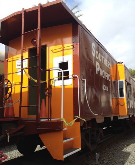 The Southern California Scenic  Railway Association, Inc. (SCSRA) former  vintage caboose 4049 with  brand-new paint job as of May 2016 Fullerton Railroad Days  at Fullerton Amtrak Station